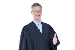 Happy handsome lawyer thumb up Stock Photography