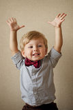 Happy handsome little boy in a bow tie Stock Photo