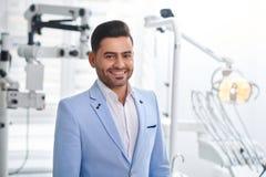 Young man visiting dentist stock photos