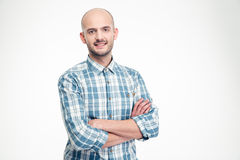 Happy handsome man in checkered shirt standing with arms crossed Stock Photo