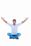 Happy handsome man cheering with arms up. On white background Royalty Free Stock Photo