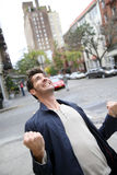 Happy handsome man expressing joy Royalty Free Stock Photo