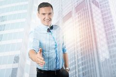 Happy handsome man greeting you. Pleasant meeting. Happy positive handsome man smiling and looking at you while greeting you Stock Photo