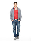 Happy handsome man in grey jacket, blue jeans. Full portrait of smiling happy handsome man in grey jacket, blue jeans. Beautiful guy standing isolated on white royalty free stock photography
