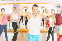 Happy handsome man with group peolpe in fitness class Stock Image
