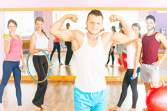 Happy handsome man with group peolpe in fitness class Royalty Free Stock Photos