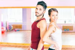 Happy handsome man with group peolpe in fitness class Stock Images
