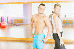 Happy handsome man with group peolpe in fitness class Royalty Free Stock Photography