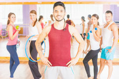 Happy handsome man with group peolpe in fitness class Royalty Free Stock Image