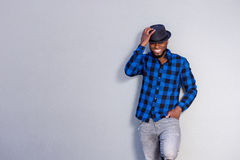 Happy handsome man having fun with hand on hat Royalty Free Stock Images