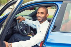 Happy handsome man in his new blue car Stock Photography
