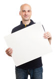 Happy handsome man holding blank paper Stock Image