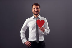 Man holding red heart and smiling Royalty Free Stock Image