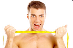 Happy Handsome Man Holding Yellow tape Measure Royalty Free Stock Photo