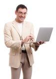 Happy handsome man with laptop Stock Photo