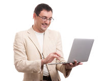 Happy handsome man with laptop Royalty Free Stock Image