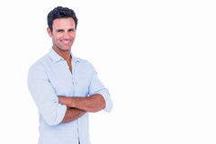 Happy handsome man looking at camera with arms crossed Royalty Free Stock Photo