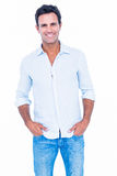 Happy handsome man looking at camera with hands in pocket Stock Photography