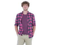 Happy handsome man looking at camera with hands in pocket Stock Photo