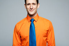 Happy handsome man in orange shirt. Stock Photography