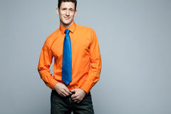 Happy handsome man in orange shirt. Stock Photo