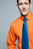 Happy handsome man in orange shirt. Royalty Free Stock Image