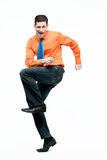 Happy handsome man in orange shirt dancing. Royalty Free Stock Photography