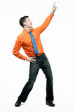 Happy handsome man in orange shirt dancing. Royalty Free Stock Images