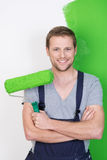 Happy handsome man painting his house Royalty Free Stock Photos