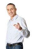 Happy handsome man pointing at you Stock Images