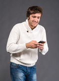 Happy handsome man sending a text message Royalty Free Stock Photo