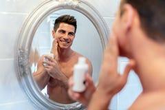 Happy handsome man shaving stock photo
