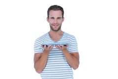 Happy handsome man showing tablet computer Royalty Free Stock Photo