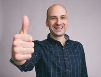 Happy handsome man showing thumbs up Stock Images