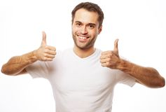 Happy handsome man showing thumbs up Stock Image