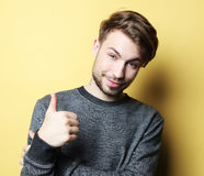 Happy handsome man showing thumbs up Stock Photography