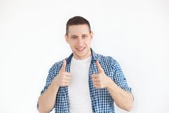 Happy handsome man showing thumbs up. A stylish man in a shirt has a smiling look, advertises a product. People, advertising, emot stock photos