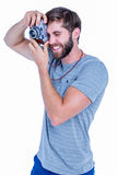 Happy handsome man taking pictures Royalty Free Stock Images