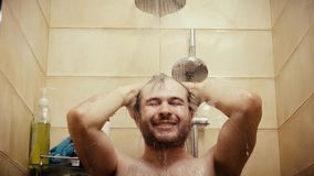 Happy handsome man taking shower close-up shot. Happy handsome man taking shower Royalty Free Stock Photos