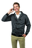 Happy handsome man talking on mobile phone Royalty Free Stock Images