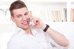 Happy handsome man talking on the phone Stock Photography