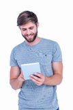 Happy handsome man using tablet computer Royalty Free Stock Image
