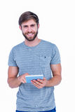 Happy handsome man using tablet computer Stock Image