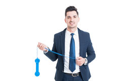 Happy handsome salesman using a blue vintage telephone Stock Photos