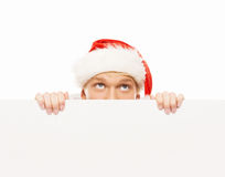 Happy and handsome teenage guy in a Christmas hat and a banner Stock Images