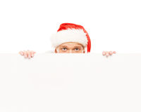 Happy and handsome teenage guy in a Christmas hat and a banner Royalty Free Stock Image
