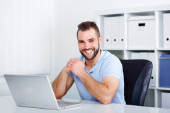 Happy handsome young business man working royalty free stock photography