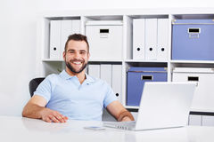 Happy handsome young business man working Stock Photos