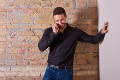 Happy businessman talking on the phone stock photo