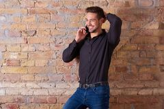 Happy businessman talking on the phone stock image